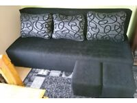 Black Sofa Bed and 2 Pouffes