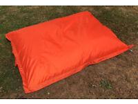 Large orange outdoor cushion