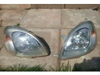 Toyota yaris front head lights both with bulbs good condition CHEAP