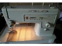 Singer heavy duty electric sewing machine complete with foot pedal