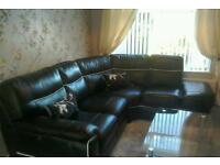 Corner sofa - 100% real leather - black with white piping - immaculate condition - must be seen.