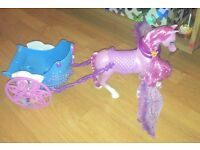 Barbie dolls including fairy horse & carriage.