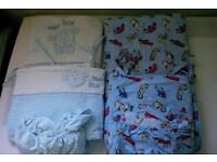 Two sets of cot bedding