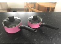 X2 pink saucepans