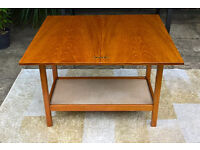 A Lovely Teak Metamorphic Cards Table with storage compartment.
