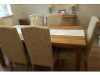 Laura Ashley solid oak dining table with six upholstered chairs