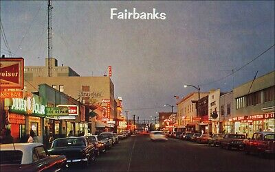 Avenue Main Street (Main Street: Second Avenue, Stores, Cars in the Evening. Fairbanks, AK. 1960s.)
