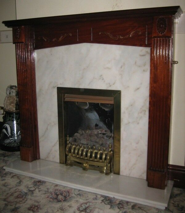 Mahogany fire surround with marble back and gas fire