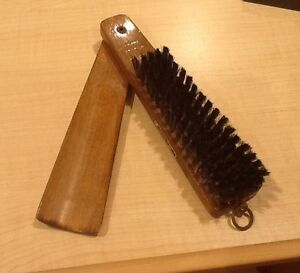 Antique shoehorn and brush Nieman Marcus