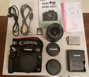 Canon EOS Rebel XS 1000D + Lense + Memory Card + Wires + Battery