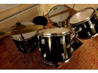 Black five piece drum kit with cymbals