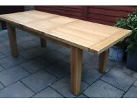 Large Solid Oak Extending Dining Table. Never Used !!