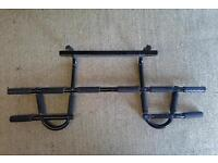 Door mounted pull up exercise bar