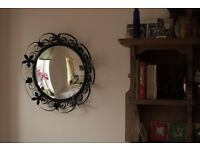 Pretty 1950s convex fish eye mirror with black ornate frame. Mid-century.