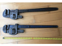 "Two pairs of Stilson pipe wrenches. Plumbers tools. 24"". Very heavy duty."