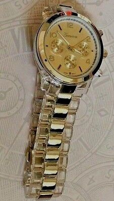 (Geneva Silver Women's Watch Gold Dial on a Transparent & Silver Linked Band New!)