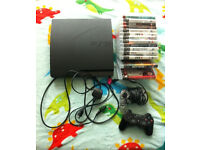 Play station 3 plus 14 games 2 controllers