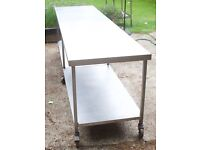 3 Metre Centre Bench Stainless steel on Casters with under shelving - two available
