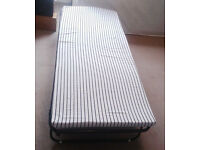 Folding metal guest bed