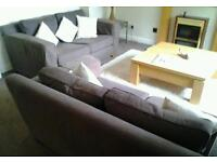2 two to three seater settees in dark brown fabric in very good condition