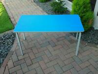 Brand new blue laminated table with metals legs