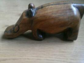 Woodern hippo 7 inches long.