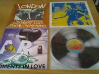 Four 12 inch records 45 rpm.