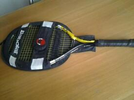 Babolat tennis racquet in carrier.