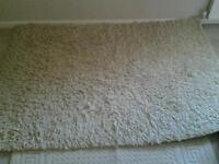 Beige shag pile wool rug