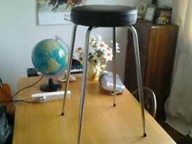 Three stools dark brown with chrome legs.