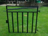 Metal garden gate painted black with fittings