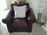 Three seat leather sofa and one leather arm chair.