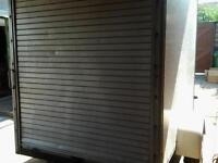 Box trailer with roll door