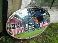 Lovely ornate oval bevelled glass wall mirror vintage