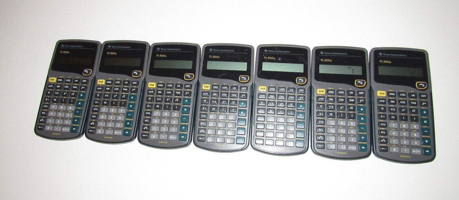 7 Texas Instruments TI-30Xa Scientific Calculators, AS IS