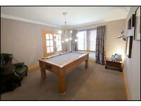 Nearly new luxury walnut pool table with grey felt top for sale.