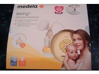 Medela Swing Electric Breast Pump with TWO Calma 150ml bottles £60 ONO