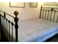 Genuine Victorian 4 foot Iron bedstead with slatted wooden base and mattress.