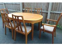 retro vintage 70`s teak extendable dining table and six matching chairs