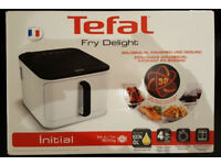 New boxed Tefal Fry Delight Initial low fat fryer from a smoke and pet free house