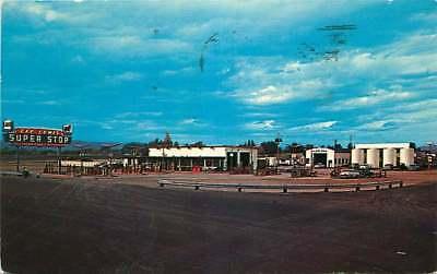 Roadside Postcard Lee Lewis Gas Station & Cafe, Kalispell, Montana - used 1961