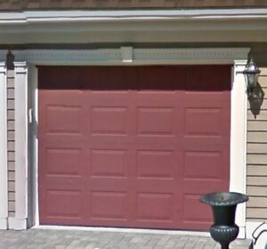 Two  9 by 7 garage doors. Excellent condition