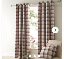 Red checked curtains with matching cushions
