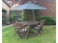 SOLID WOOD FOLDING GARDEN TABLE PLUS 6 CHAIRS, CUSHIONS AND PARASOL