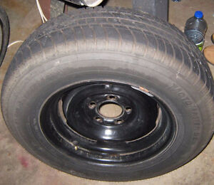 A pair of Motormaster SE Tires on rims , Hardly used