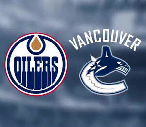 CHEAP! WoW! (7) TICKETS IN A ROW! EDMONTON OILERS vs. CANUCKS!!!