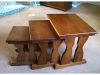NEST OF THREE MID OAK COFFEE TABLES.