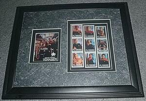 Framed Star Trek postal stamps of the Voyager series.