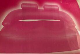 Inflatable pink sofa