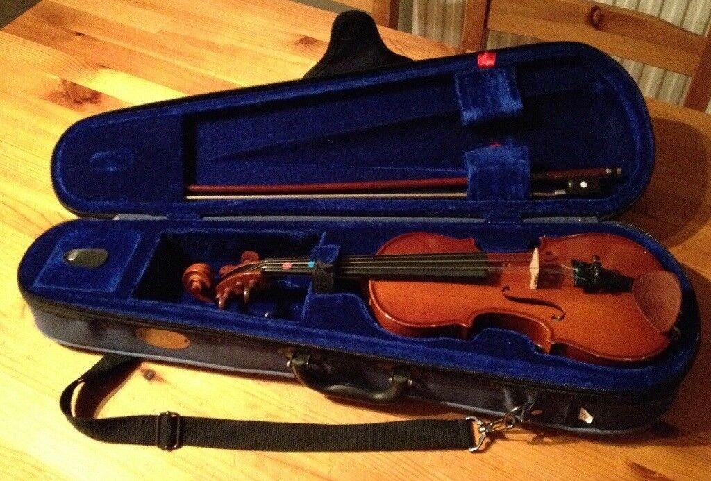 1/8 Stentor student violin, plus 3 beginner's books